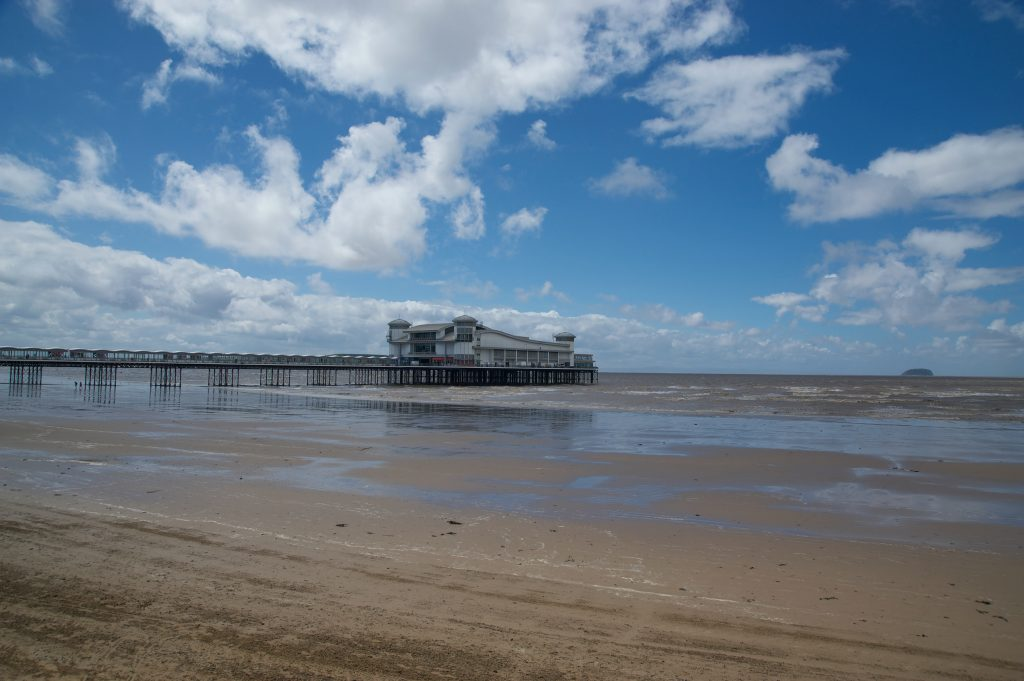 The pier at Weston Super Mare under a blue sky with some clouds